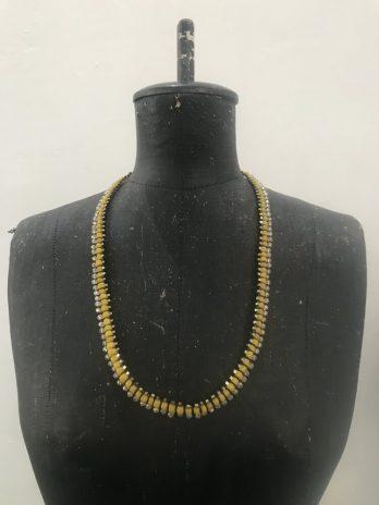 Yellow glass & hematite Centipede jewel