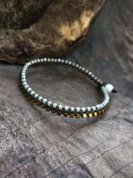 antique white and hematite anklet