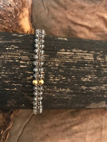 Smokey transparent & 14 krt golden bead bracelet