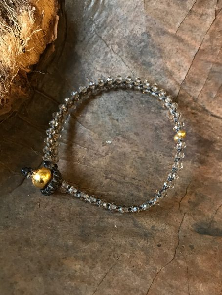 smokey transparent & 14krt golden bead bracelet