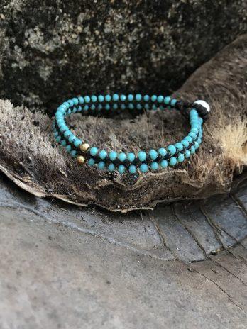 Turquoise glass & 14 krt golden bead bracelet