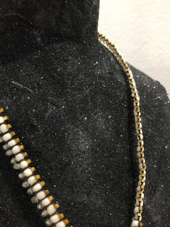 White & hematite Centipede jewel