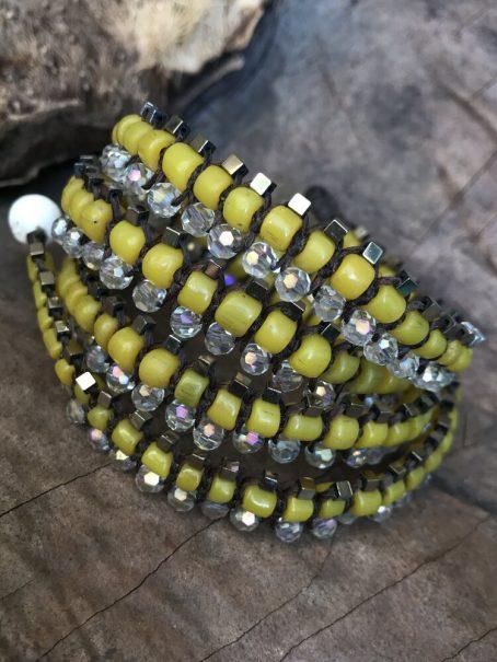 yellow glass and hematite jewel