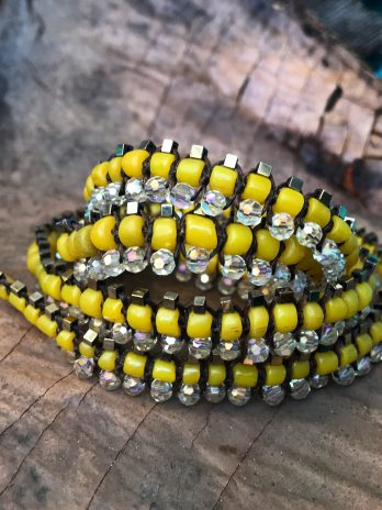 Yellow glass & hematite Centipede jewel